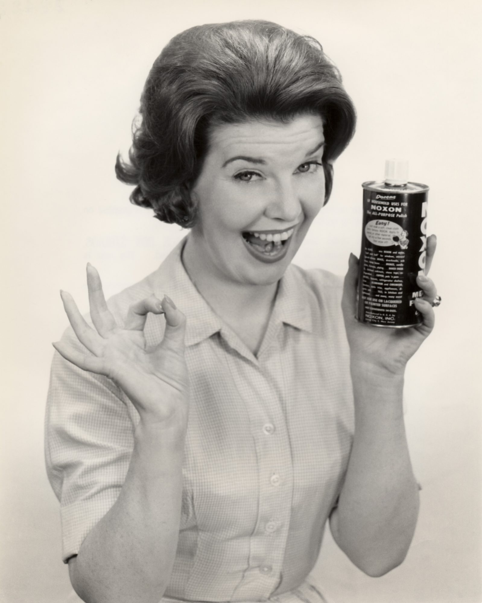 Portrait of a woman holding can of Noxon