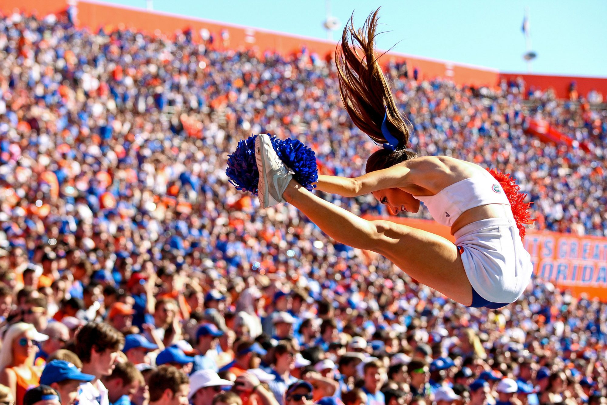 A Florida Gators cheerleader is tossed in the air during the second half of the game against the Vanderbilt Commodores at Ben Hill Griffin Stadium on November 7, 2015 in Gainesville, Florida.