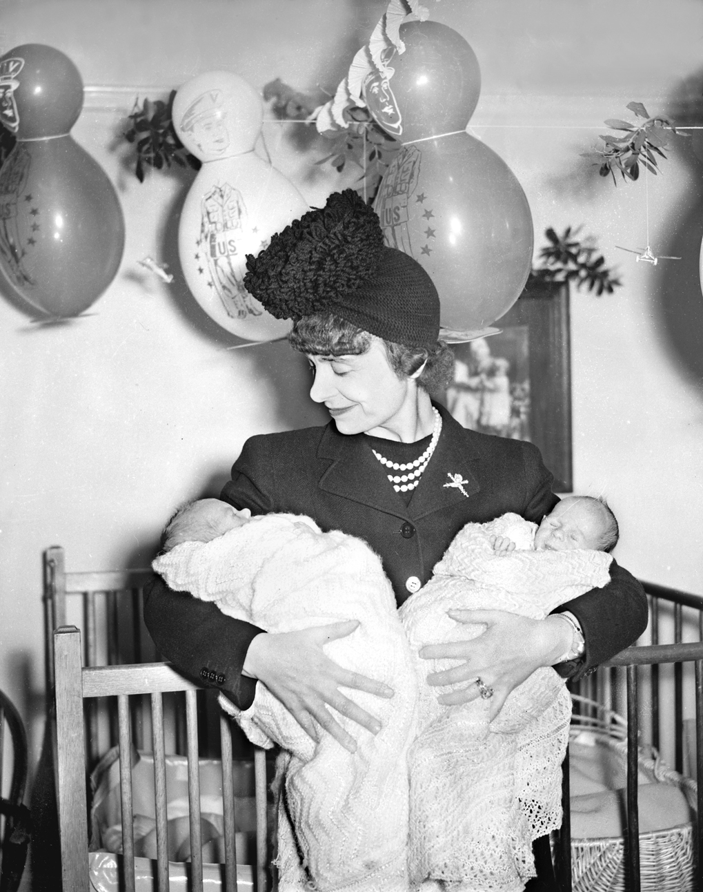 Woman Holding Twin Babies
