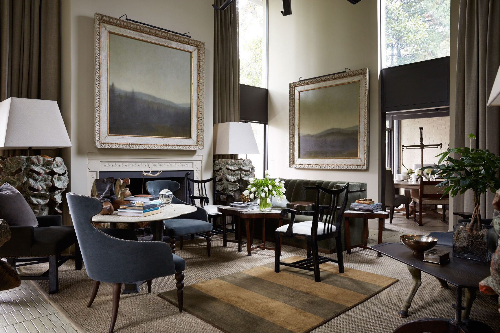 Dark Living Room with Mountain Paintings