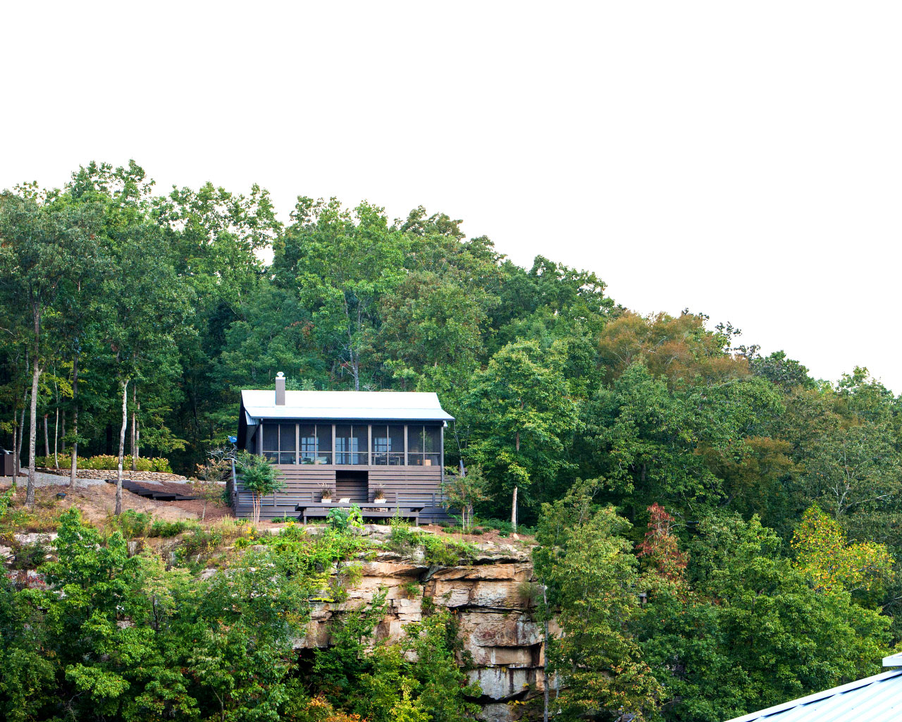 Brown Lakeside Cabin on Cliff