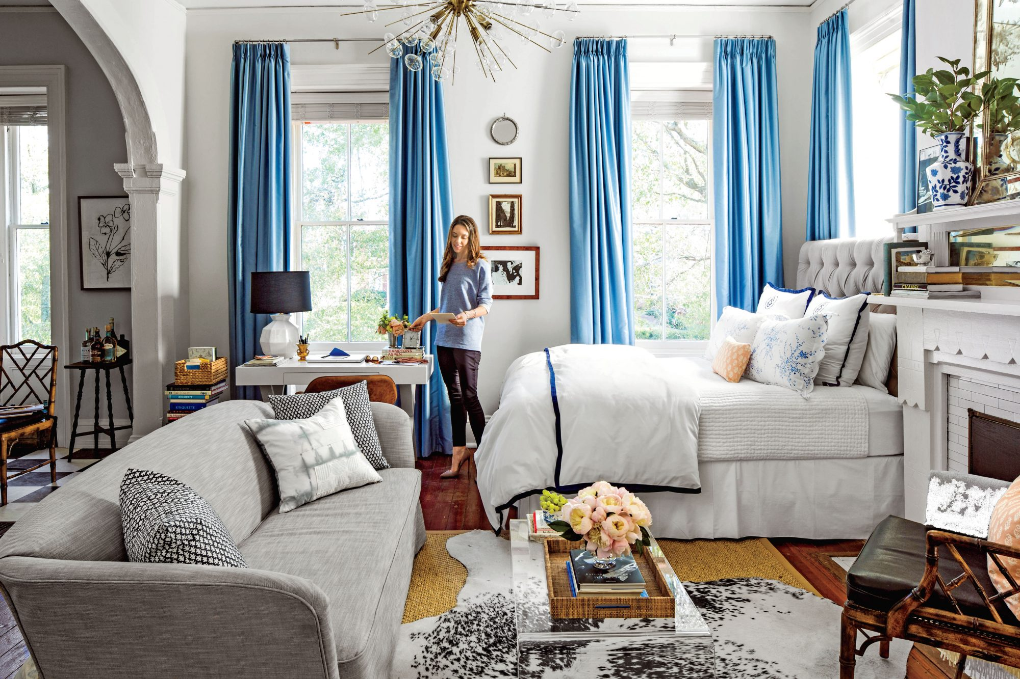 Double Rugs in Studio Apartment & 50 Best Small Space Decorating Tricks We Learned in 2016 - Southern ...