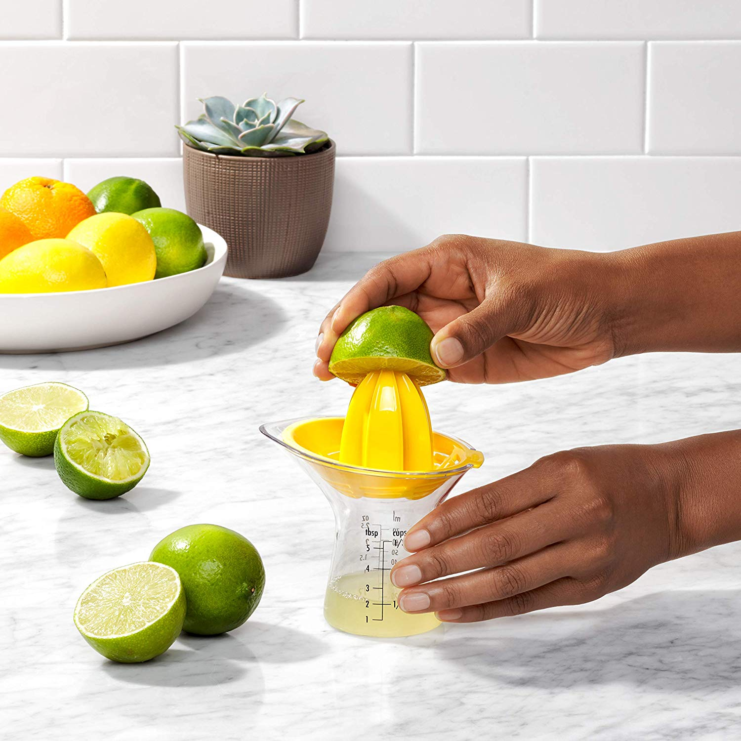 Citrus Juicer with Built-In Measurement Cup and Strainer