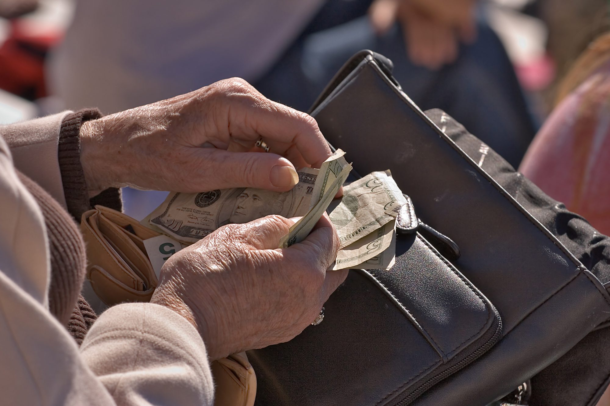 Elderly Woman counting money