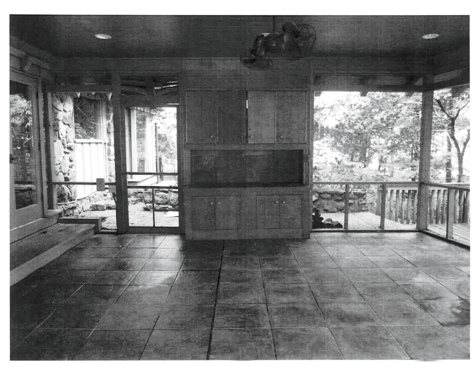 Breezy Porch with Large Cabinet Before