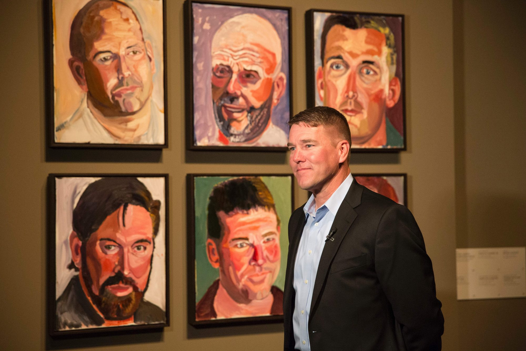 James Williamson Standing in Front of His Portrait by George W. Bush