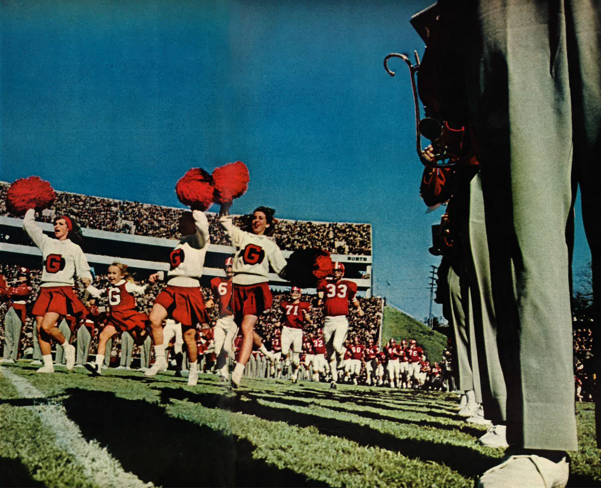 UGA Cheerleaders Running on Field