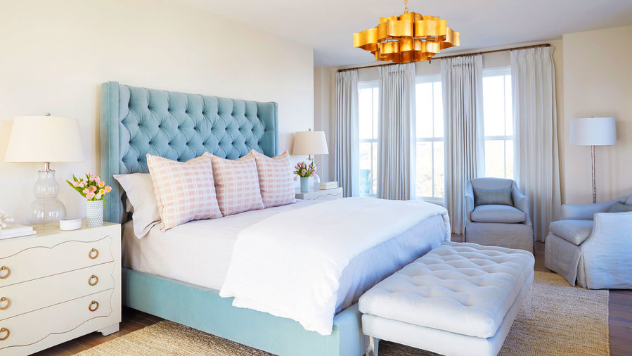 Bedroom with Blue Headboard and Pink Pillows