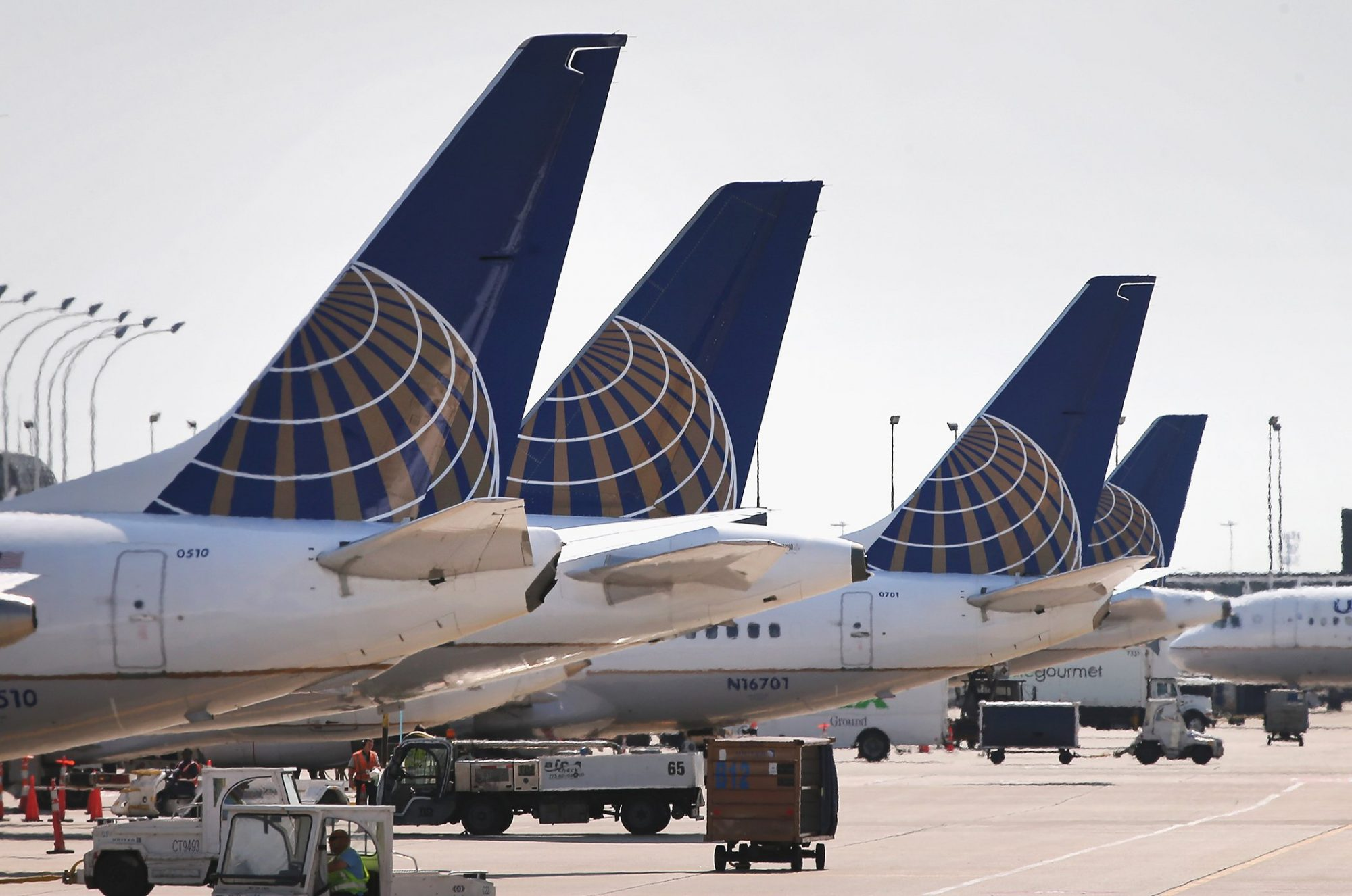 United Airlines jets sit at gates at O'Hare International Airport on September 19, 2014 in Chicago, Illinois.