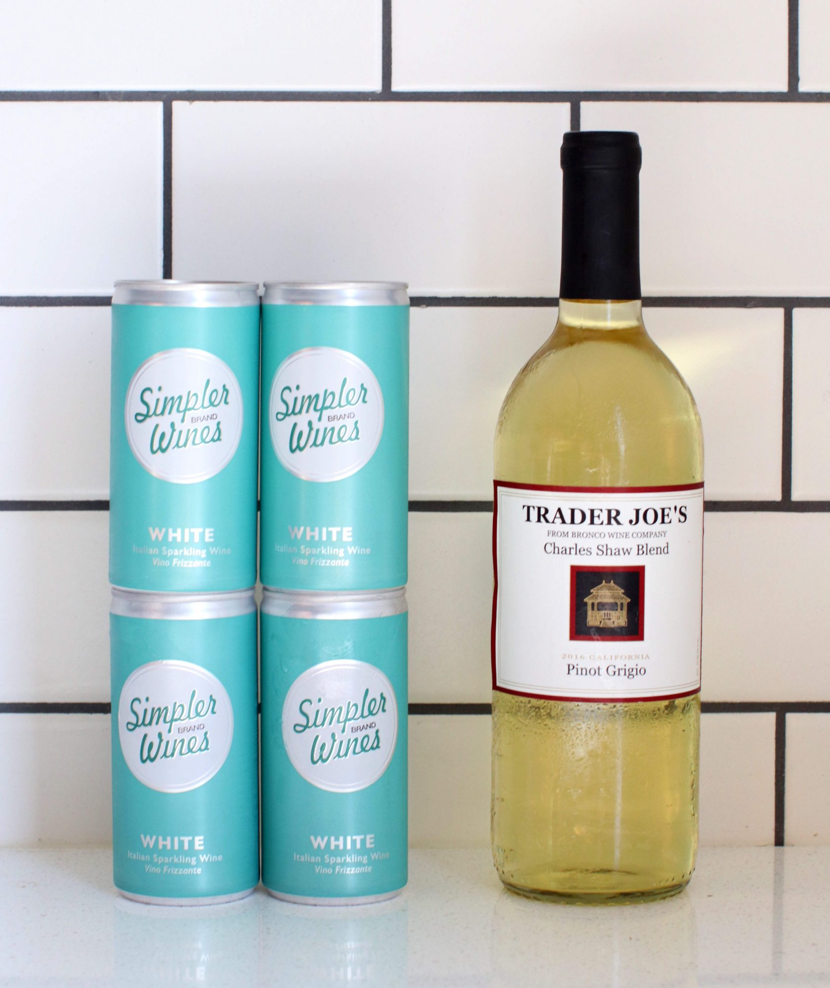 """We Taste Tested Trader Joe's New $1 Canned Wine Against """"Two Buck Chuck"""""""