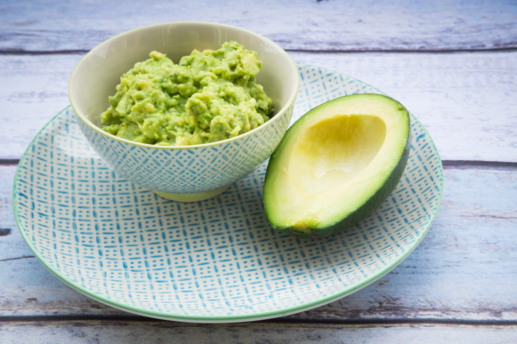 bowl guacamole half avocado