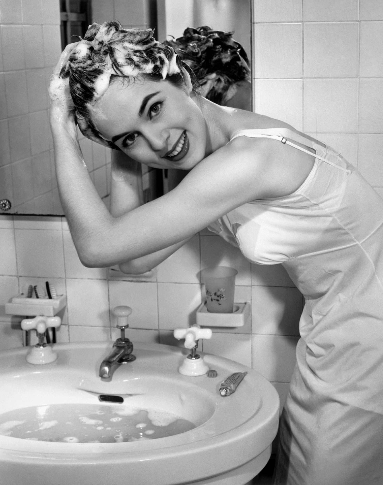 Woman Washing Hair in Sink