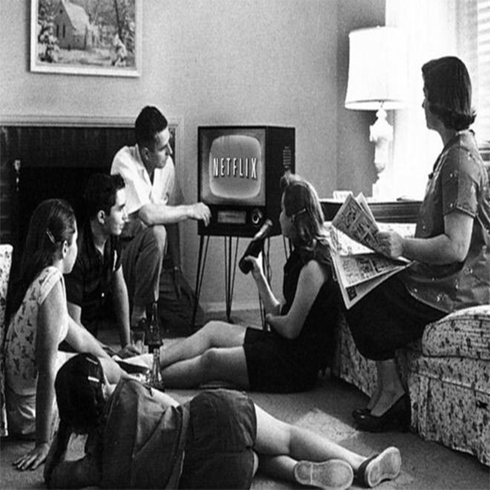 Family Sitting in Front of TV