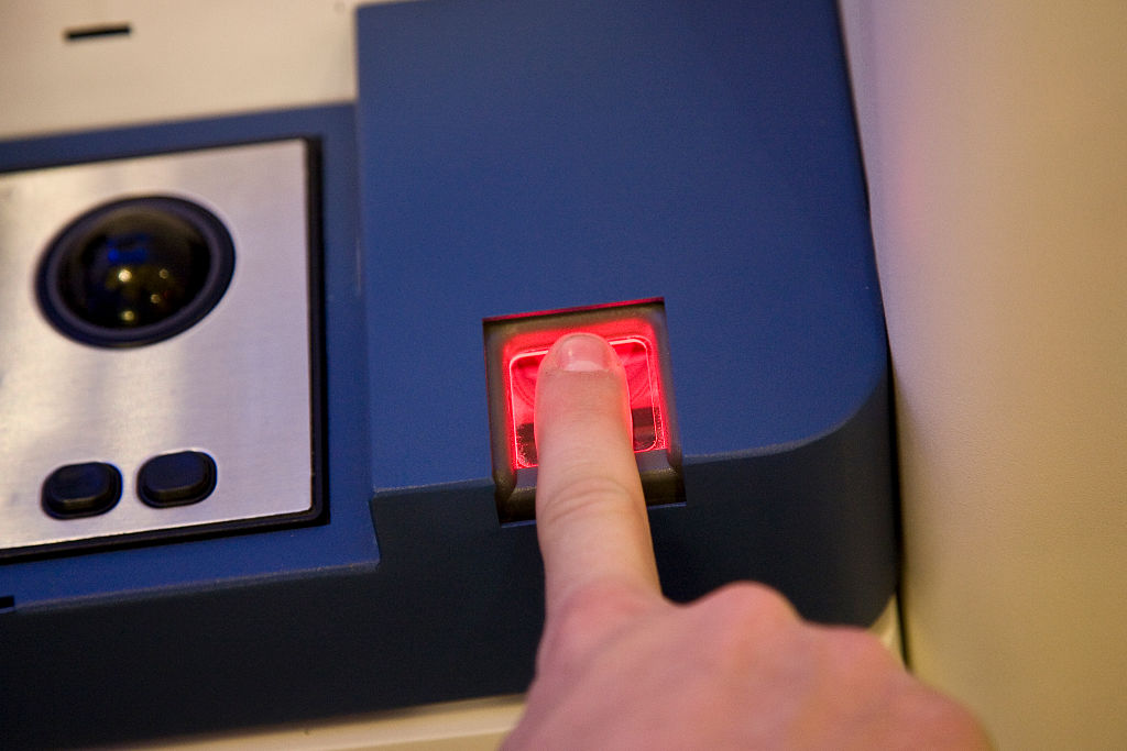 A finger print scan is taken, required to qualify for the Clear card from Verified Identity Pass, Inc. The card is part of TSA's (Transportation Security Administration) Registered Traveler program which allows travelers, for a fee, to have their backgrou