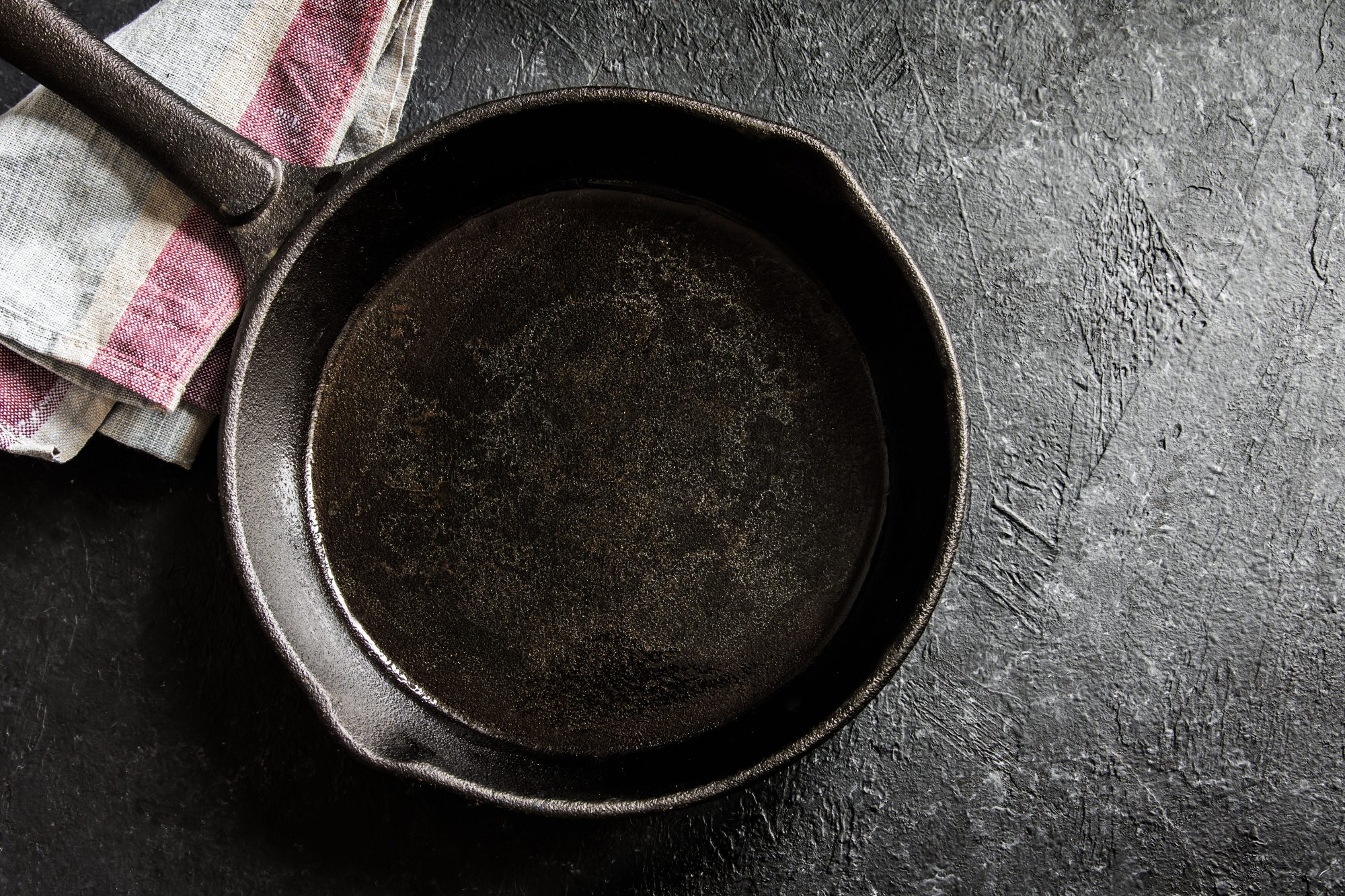 Cast-Iron Skillet on Wood Background
