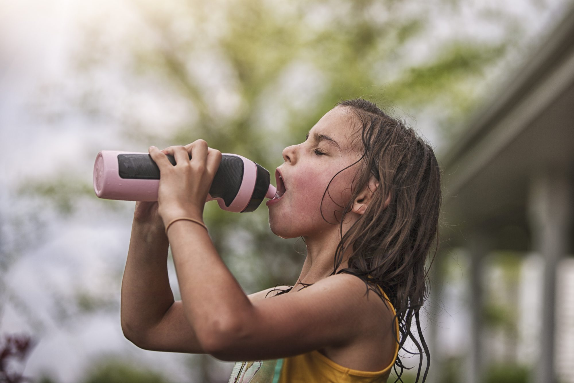 girl drinking from water bottle
