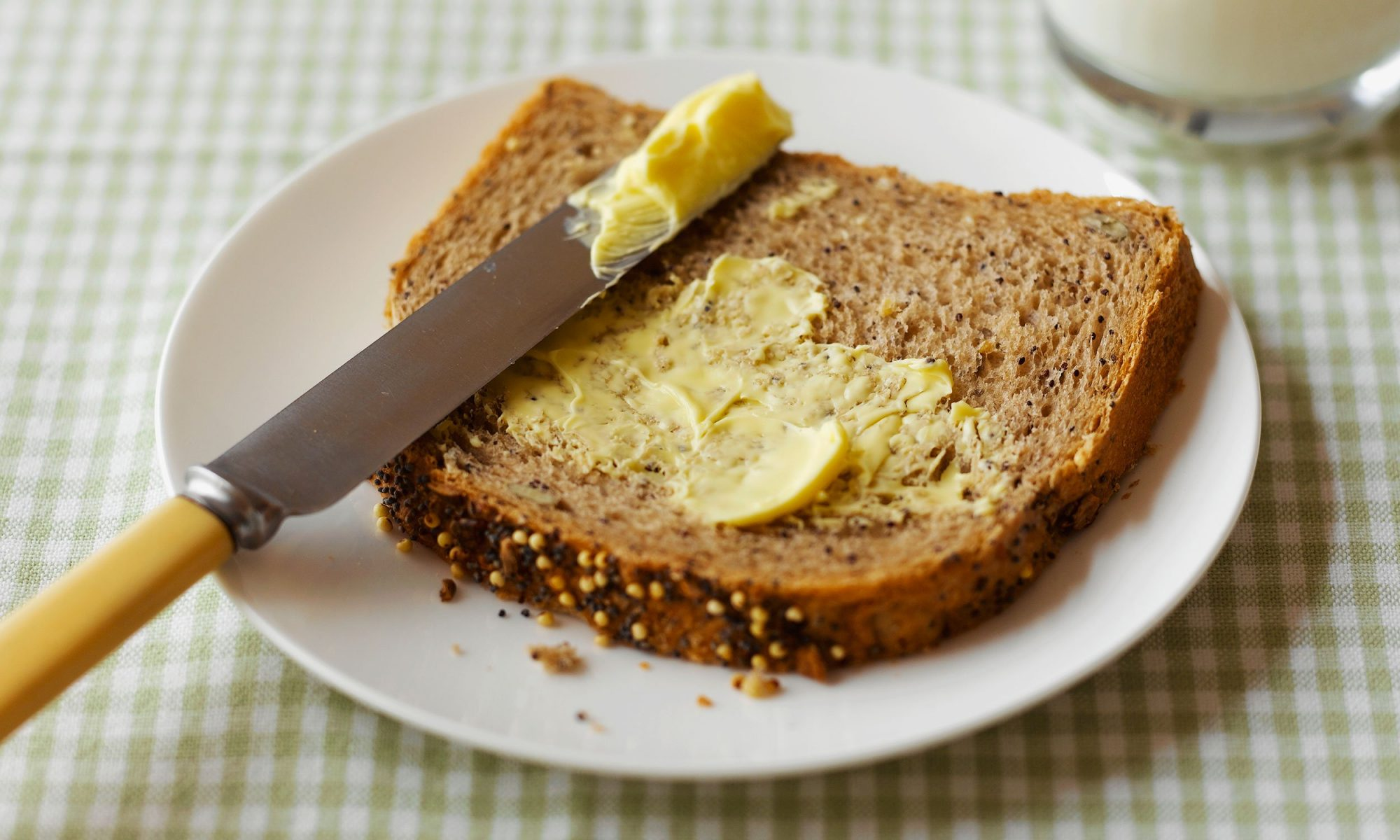 Butter spread on bread with knife