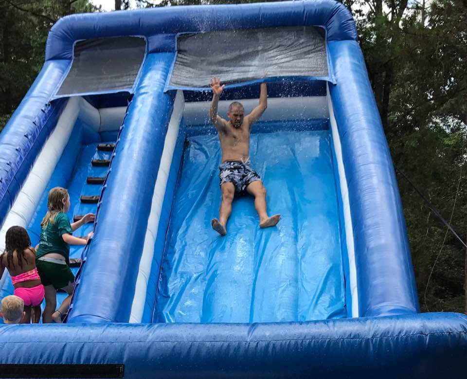 josh wimberly takes a ride down a water slide