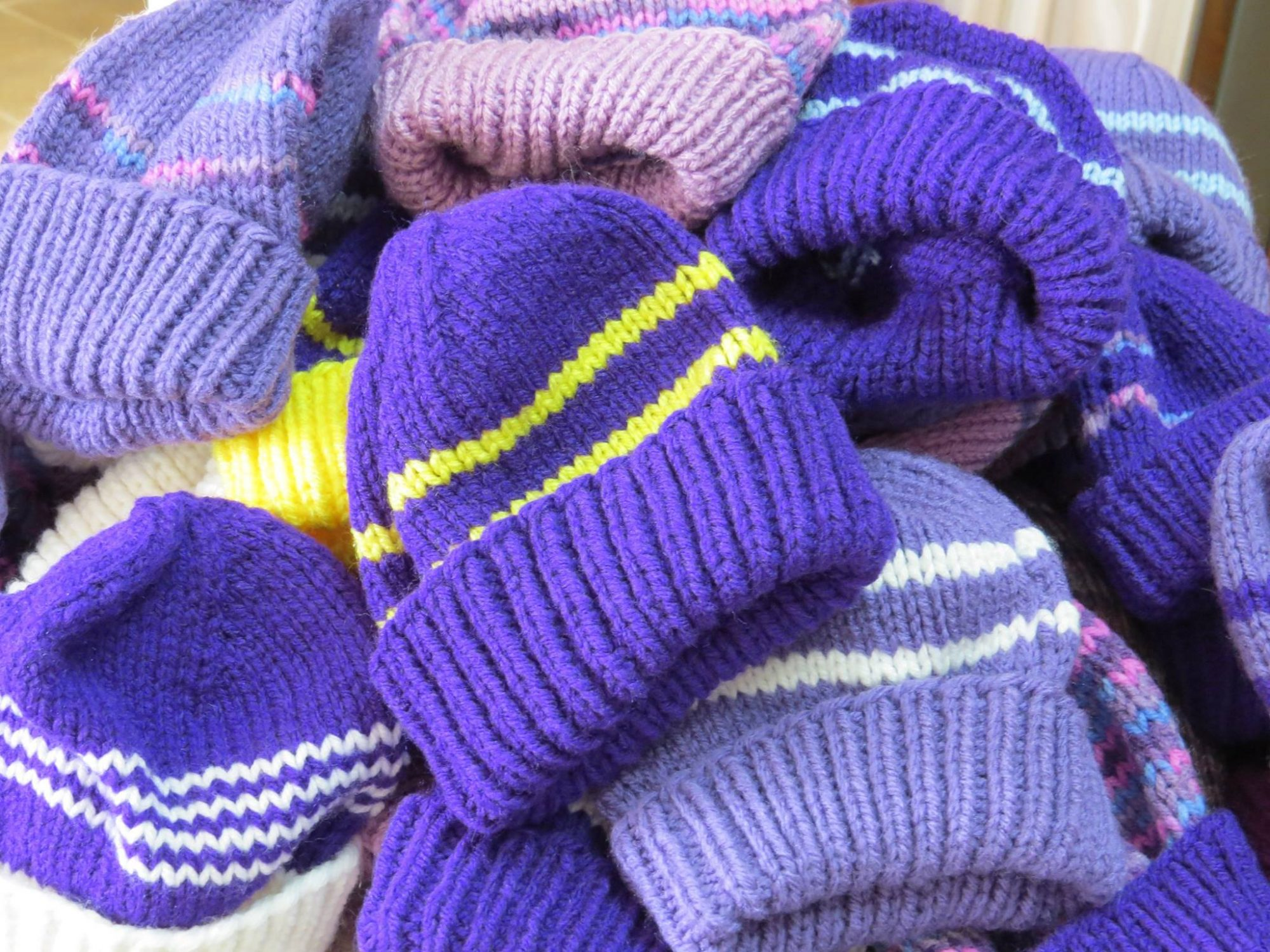 pile purple knit baby hats
