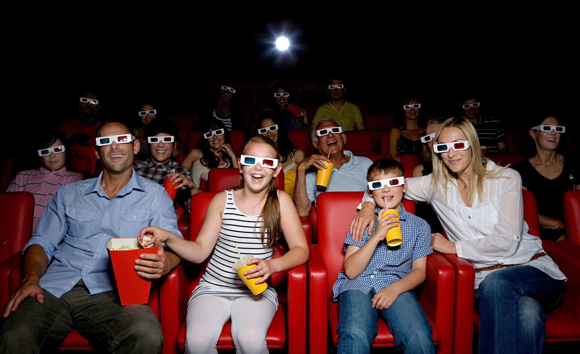 Family Watching Movie Theater