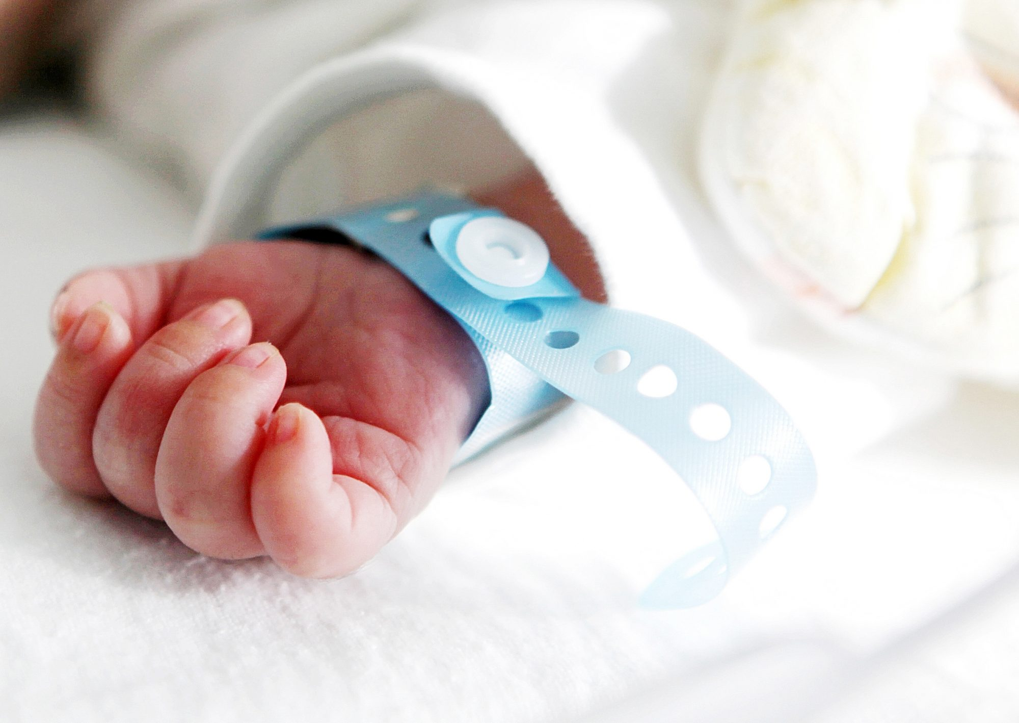Infant baby wearing a hospital band