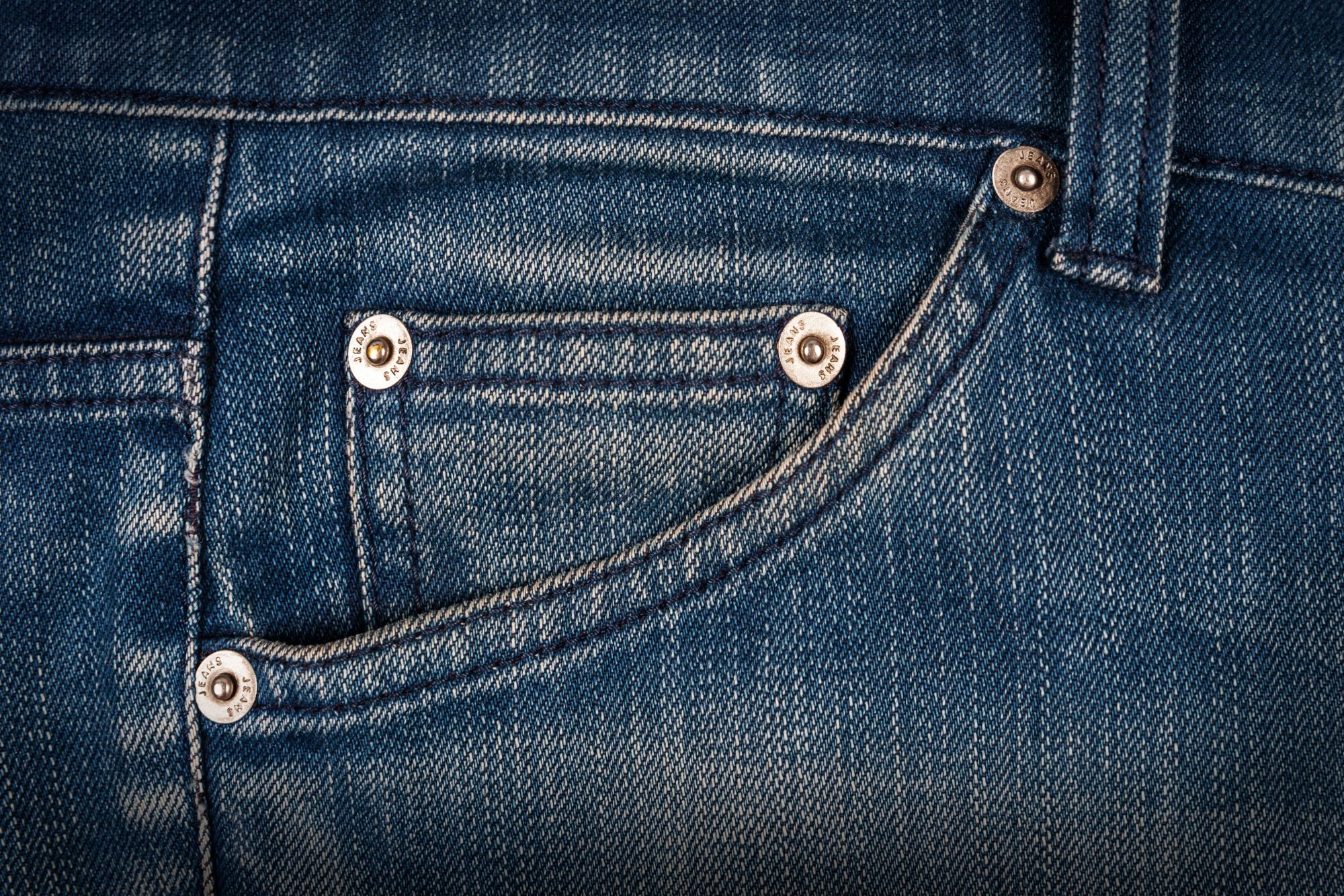Rivets on Pocket of Jeans