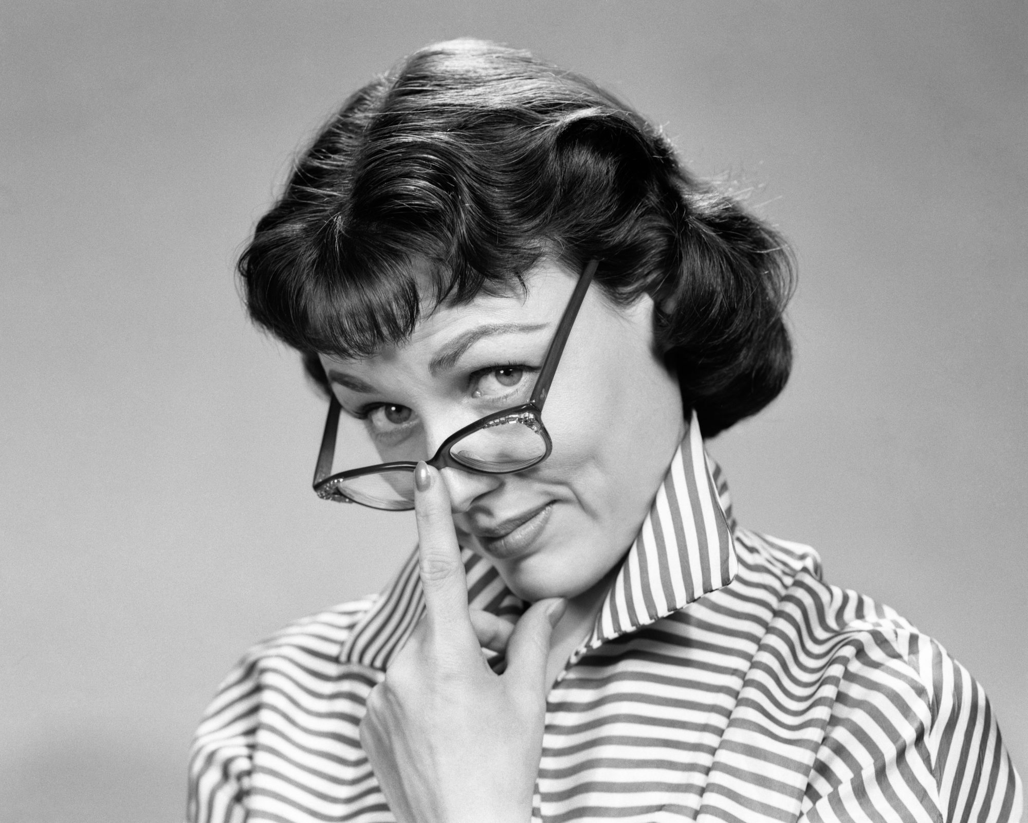 Woman Pushing Up Glasses