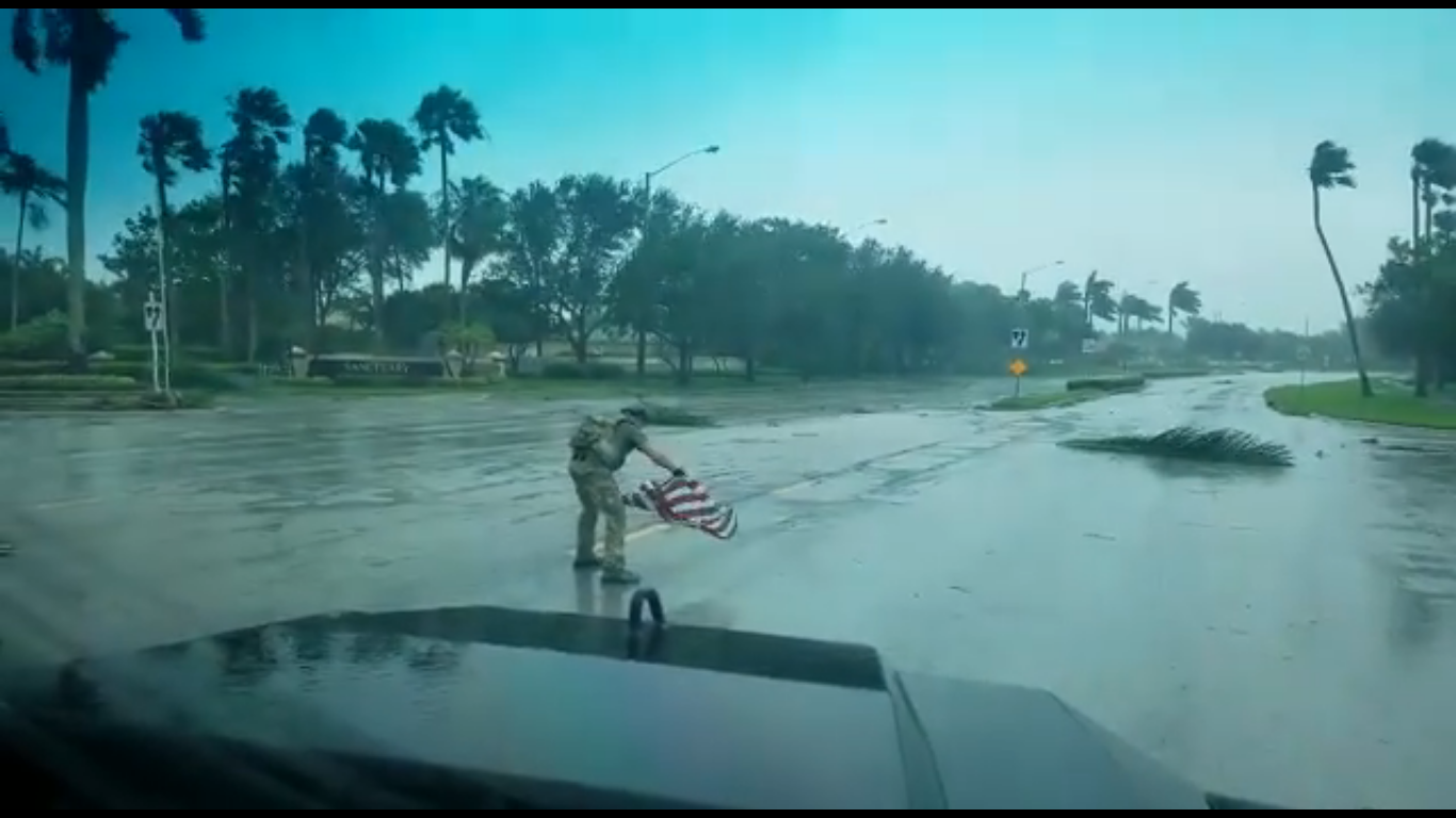Irma First Responder Picks Up American Flag