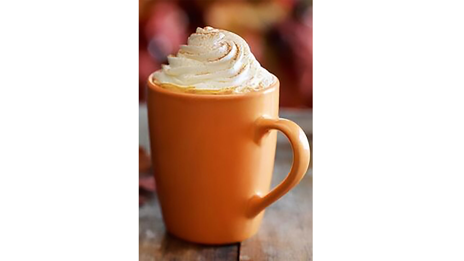 pumpkin spice latte in orange mug