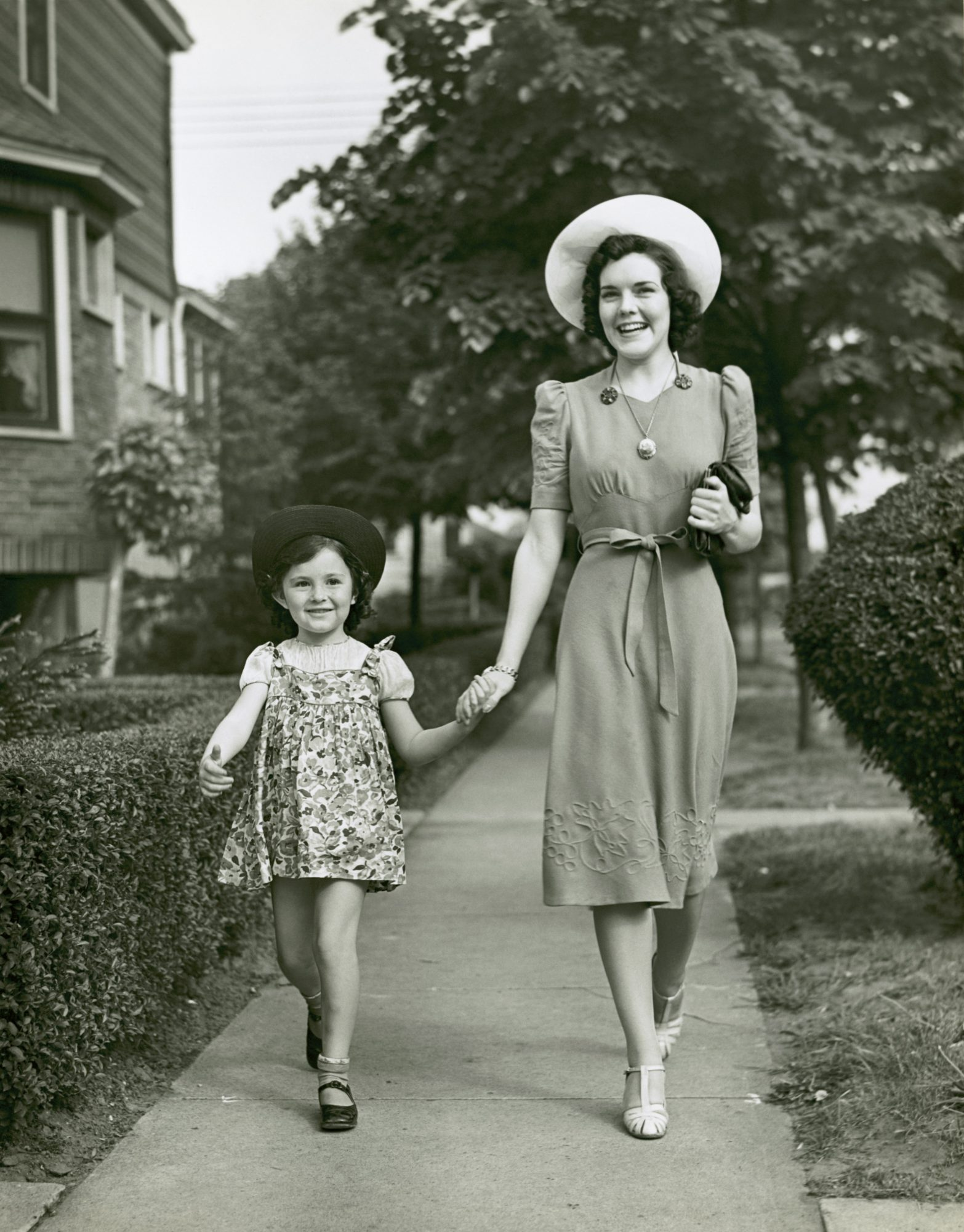 woman walking with child