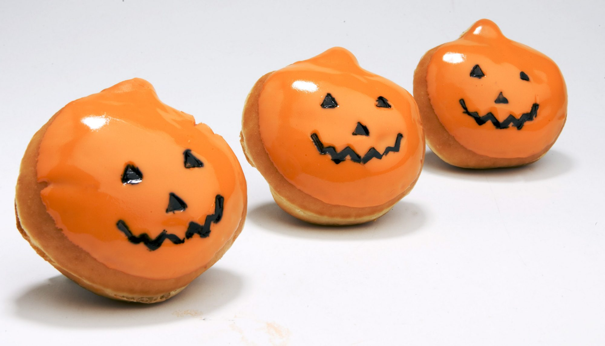 Krispy Kreme's signature doughnut gets a jack-o'-lantern shape and sweet orange frosting for a Halloween treat.