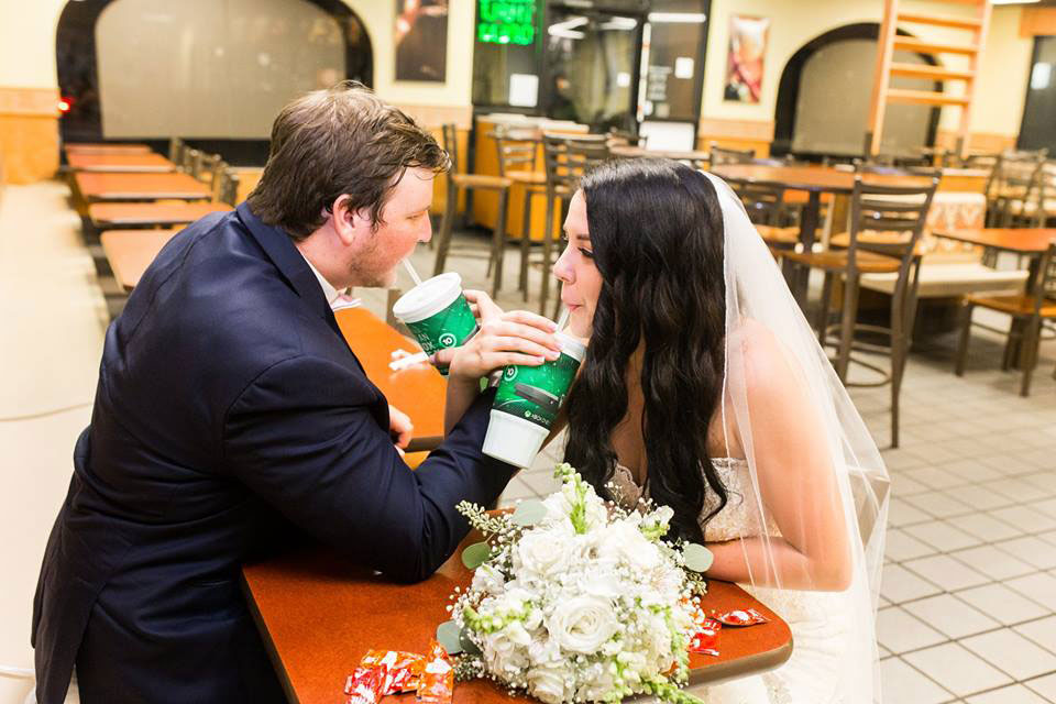 Couple Sharing Drink in Taco Bell Wedding Photo Shoot