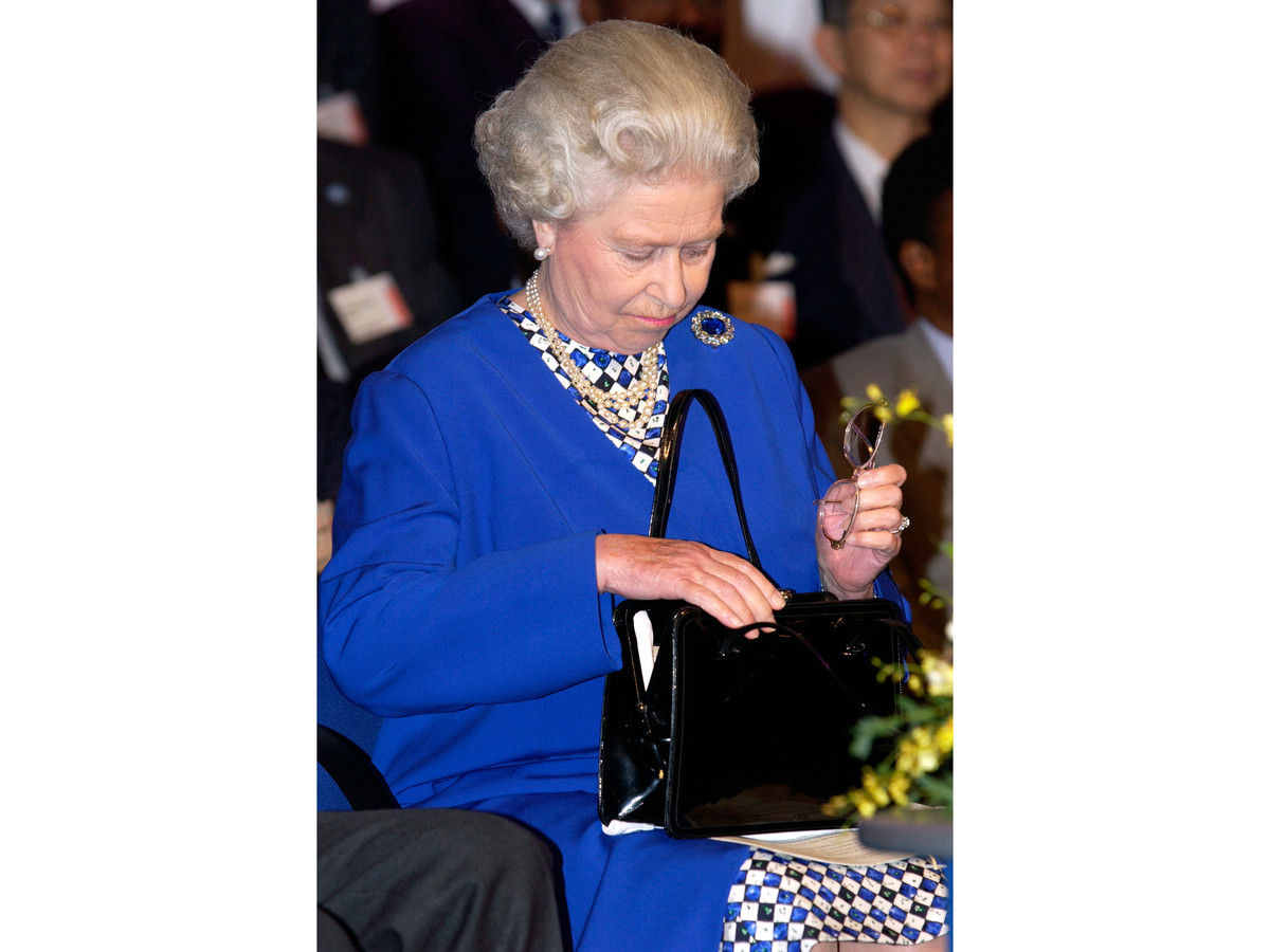 Queen Elizabeth II Pulling Glasses from Purse