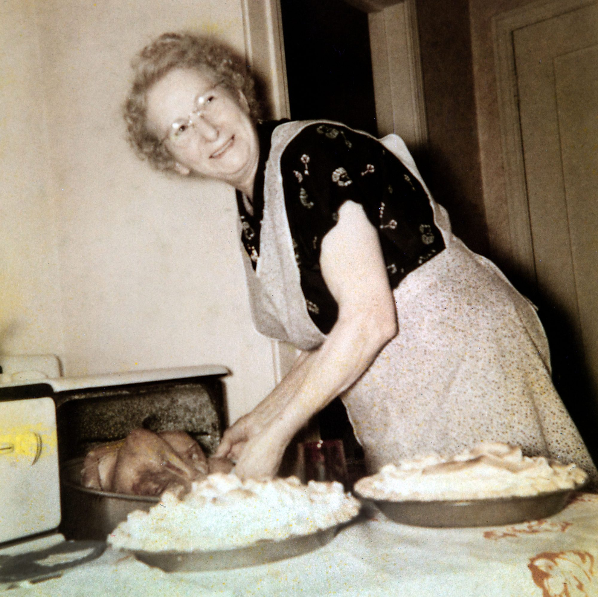 grandmother cooking turkey