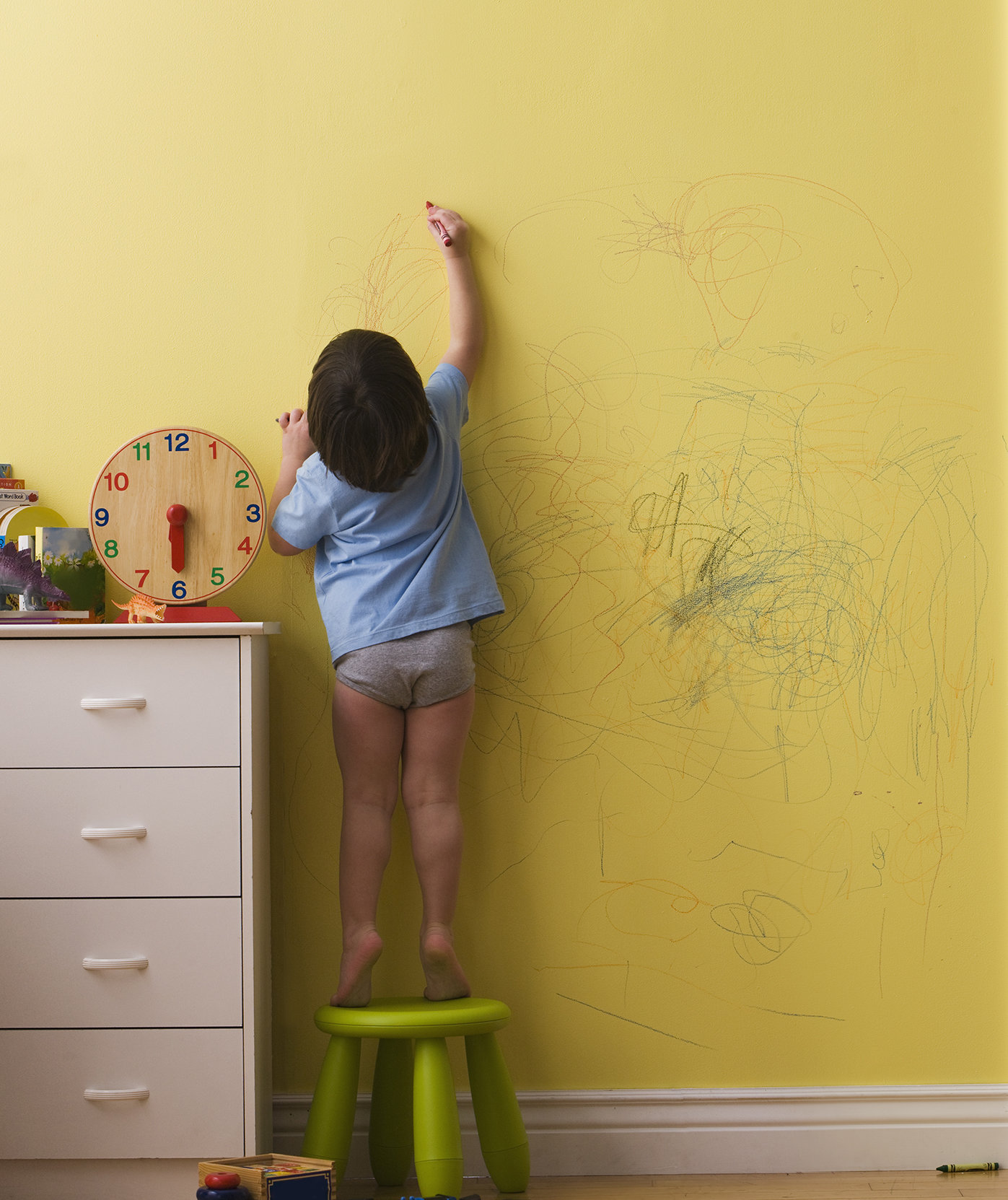 Kid Coloring on Wall