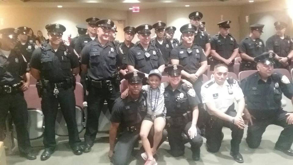Rosalyn Baldwin Hugs Police Officers in Rhode Island