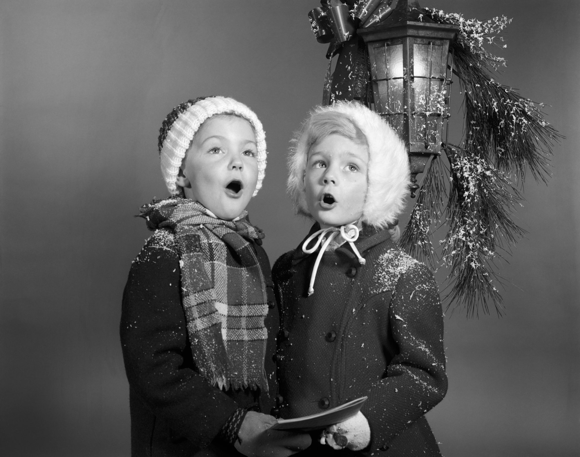 Vintage Boy and Girl Singing Christmas Carols
