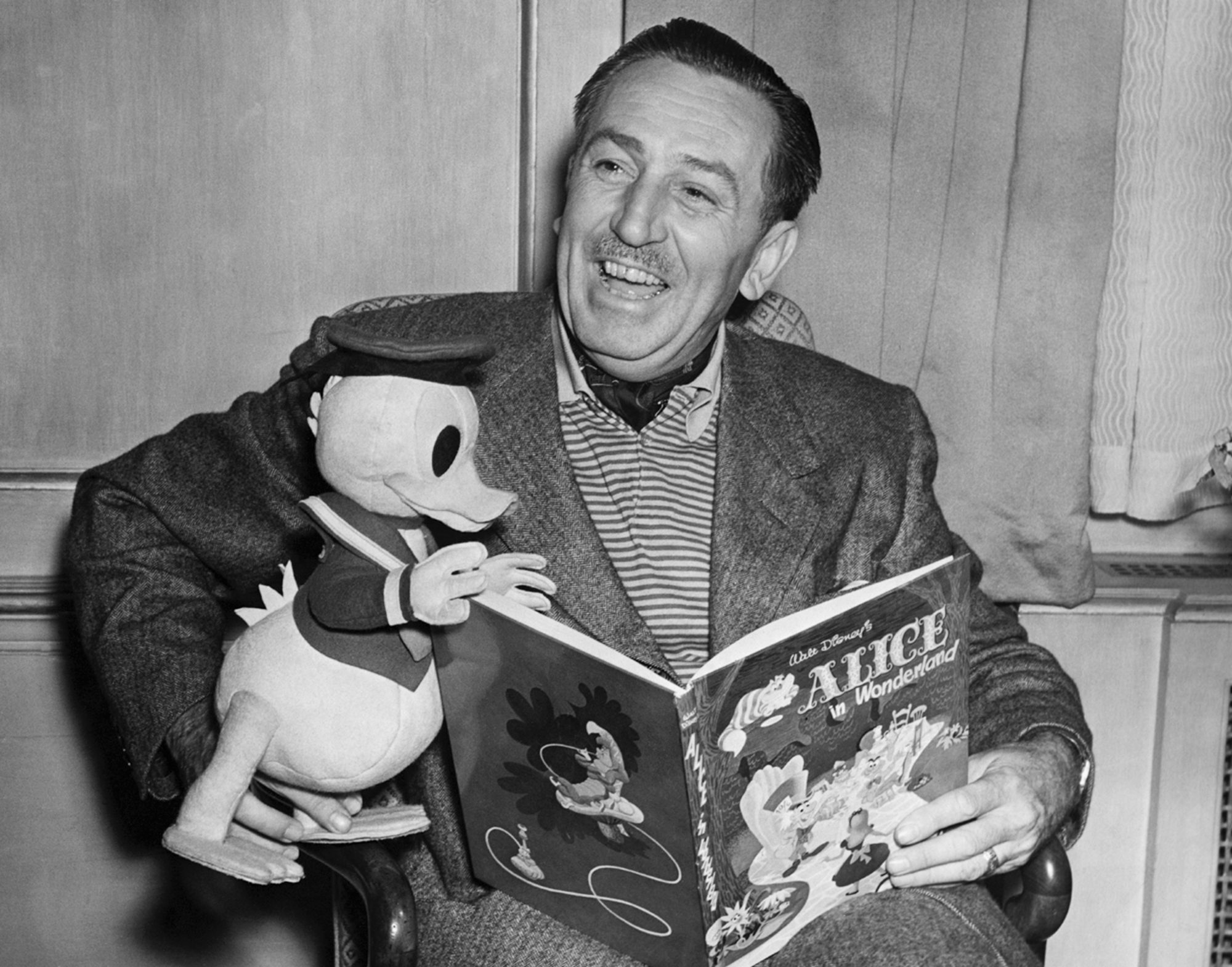 Walt Disney Reading a Book to Donald Duck