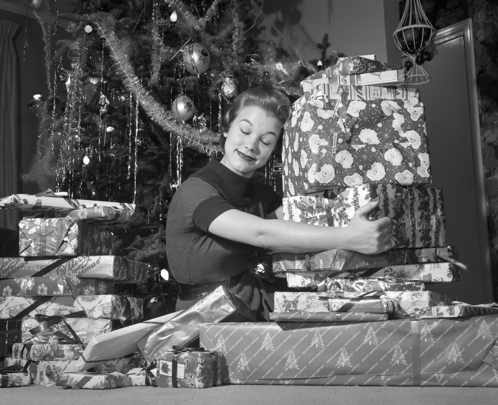 Woman Hugging Pile of Presents