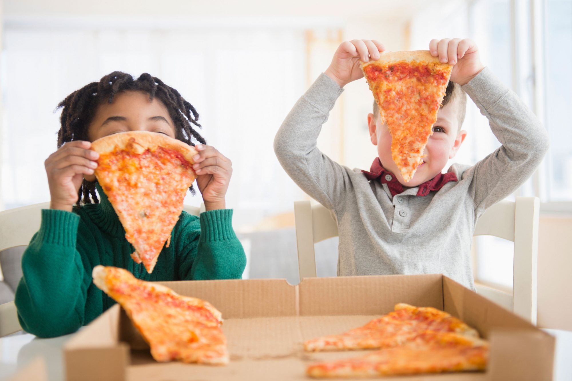 Young Boys Eating Pizza