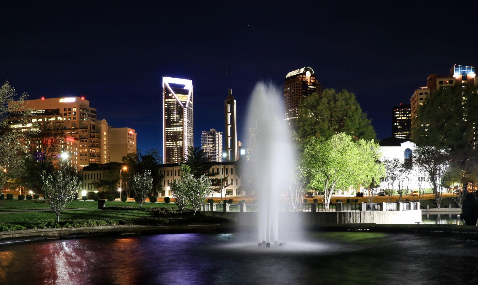 Fountain at Marshall Park with the Charlotte North Carolina skyline beyond.