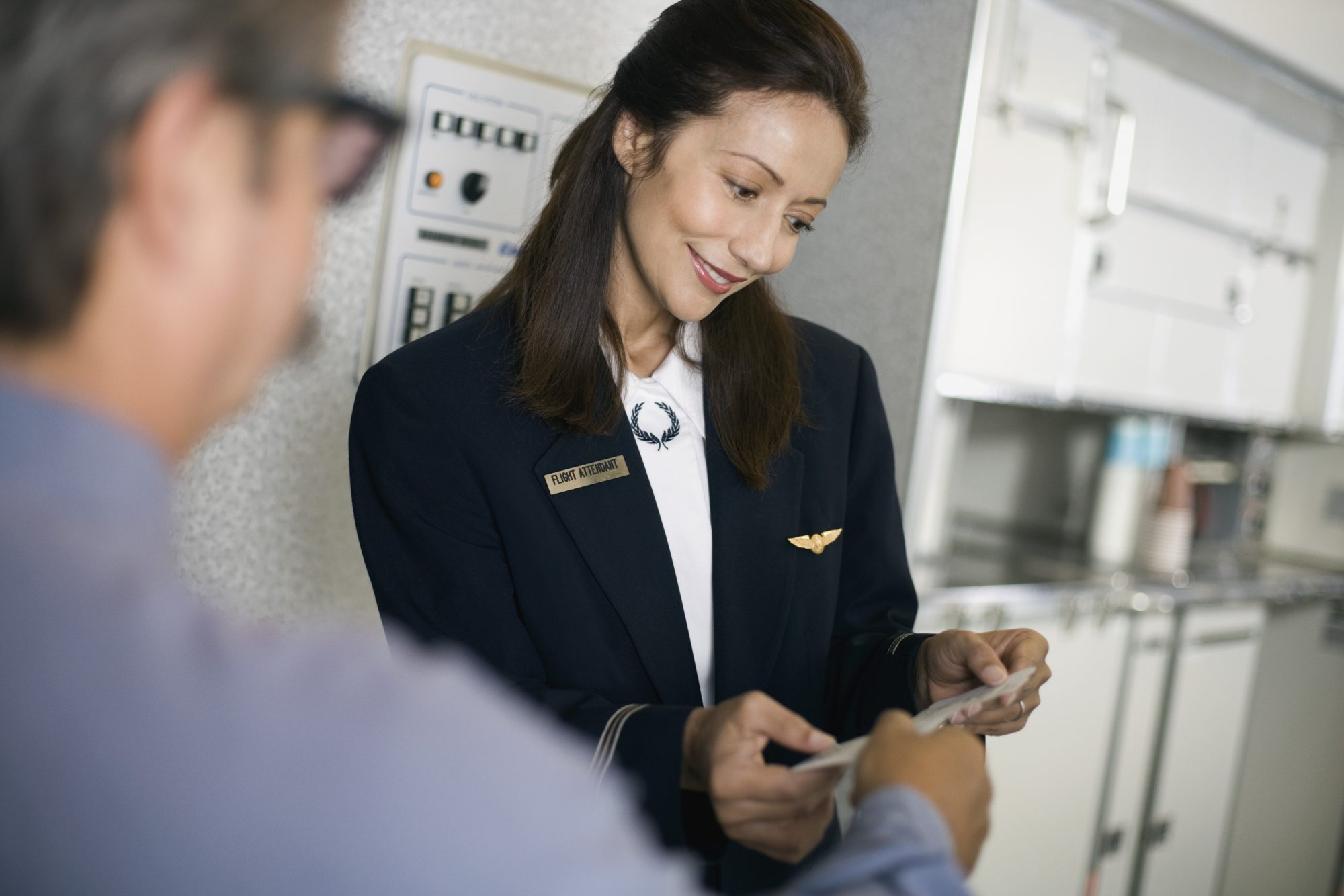 Flight Attendant Checking Boarding Pass