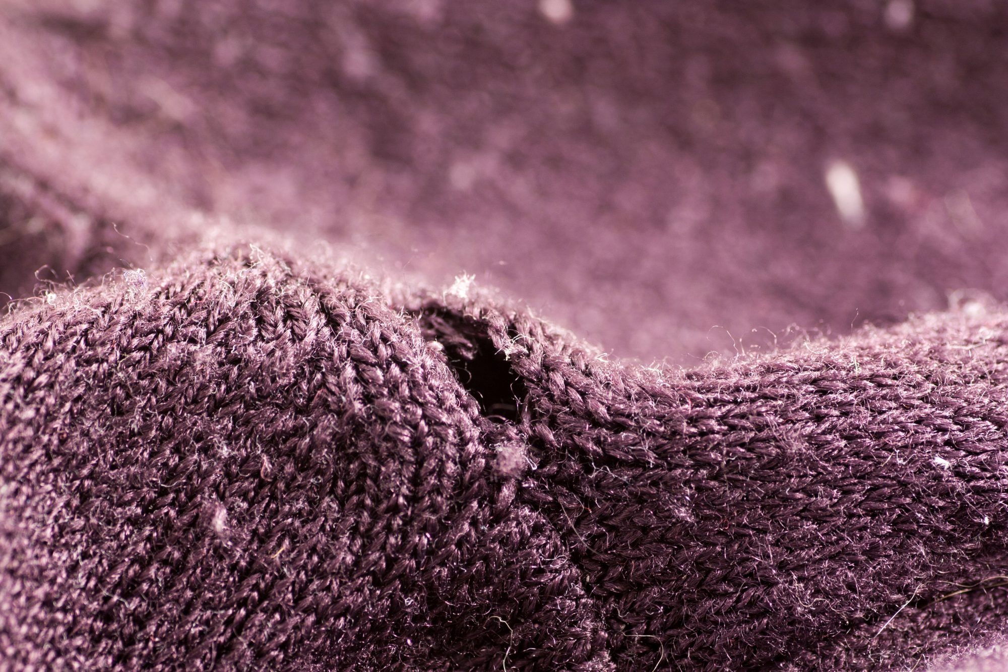 Hole in Purple Sweater