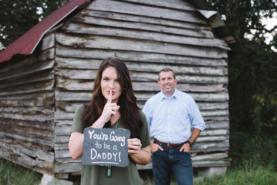 Wife Breaks Pregnancy News to Husband with Surprise Photo Shoot — and His Reaction Is Priceless