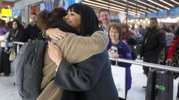 Martine McCutcheon hugging traveler at Heathrow