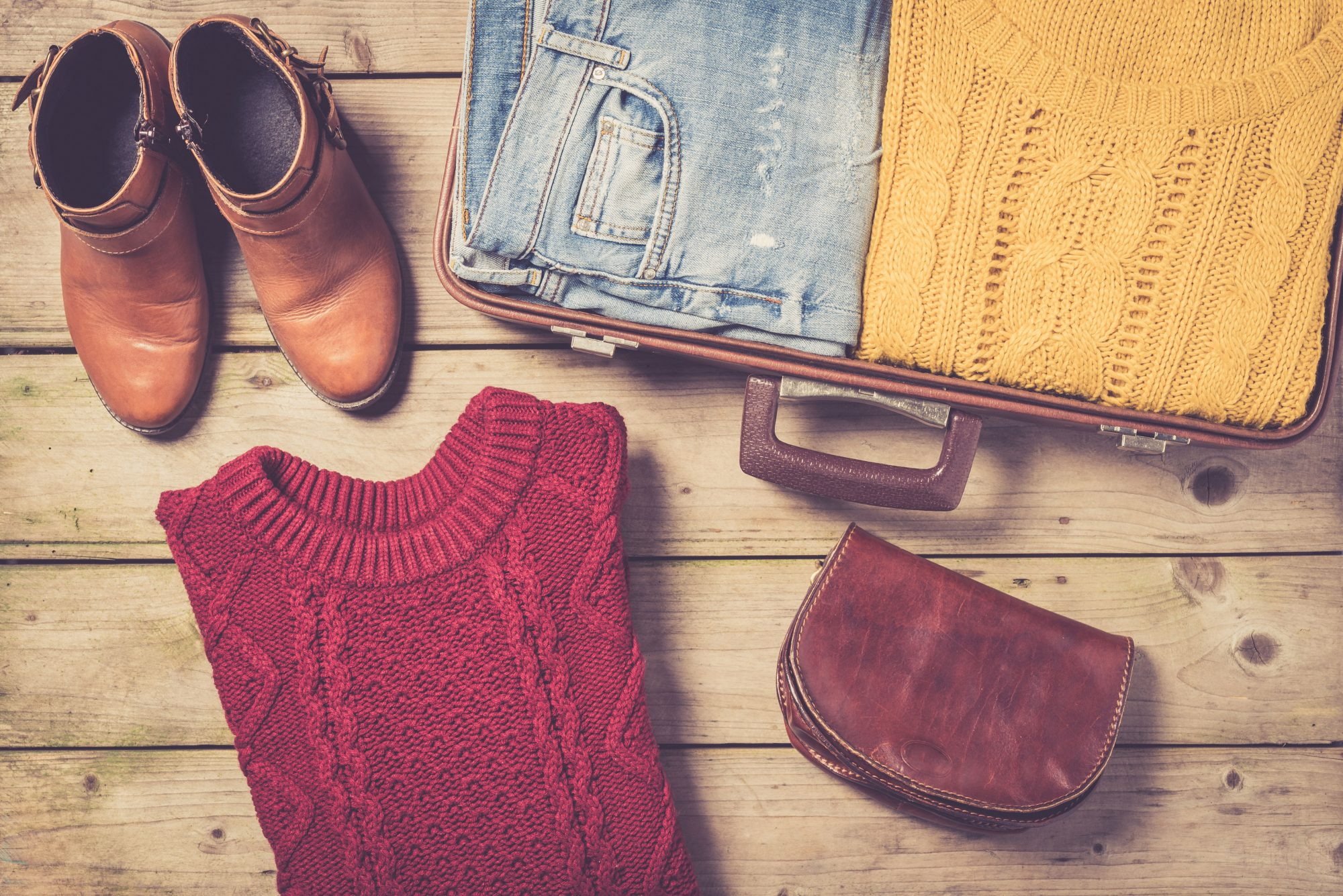 Open Suitcase with Winter Clothes
