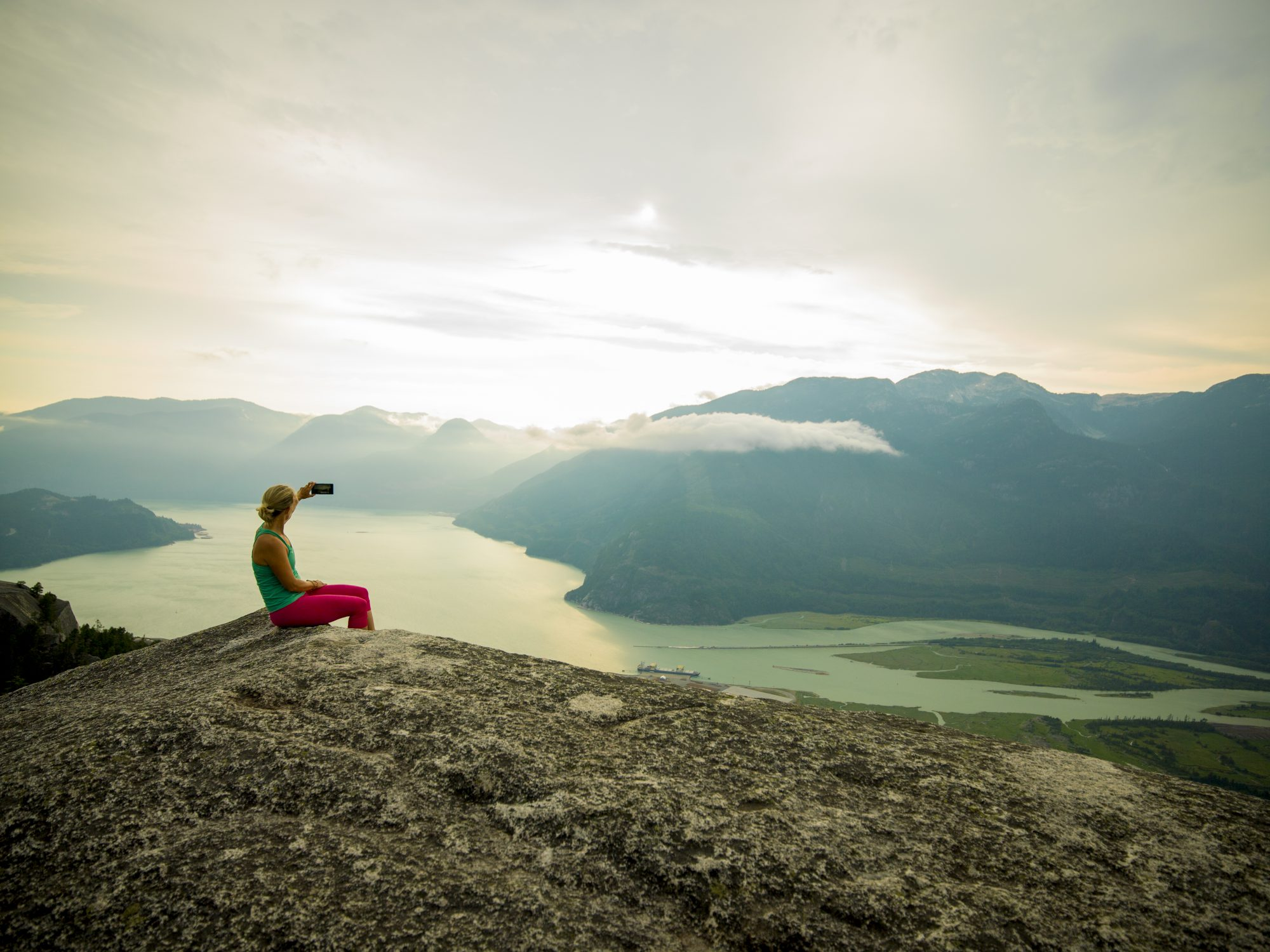 Woman Takes Selfie on Mountain Top