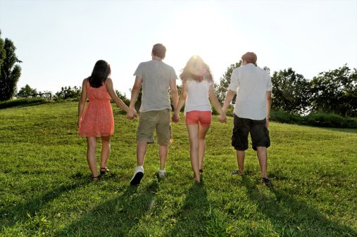 young-adults-walking-holding-hands