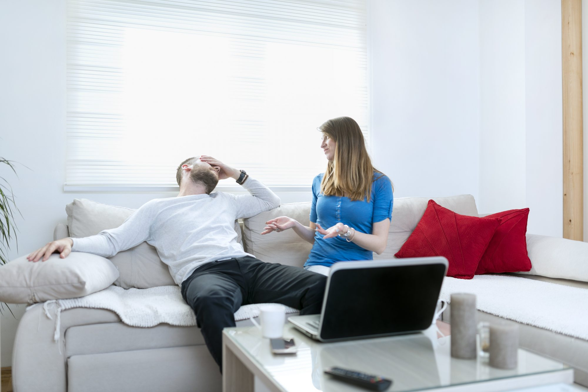 Man Suffering from Headache while Woman Quarreling