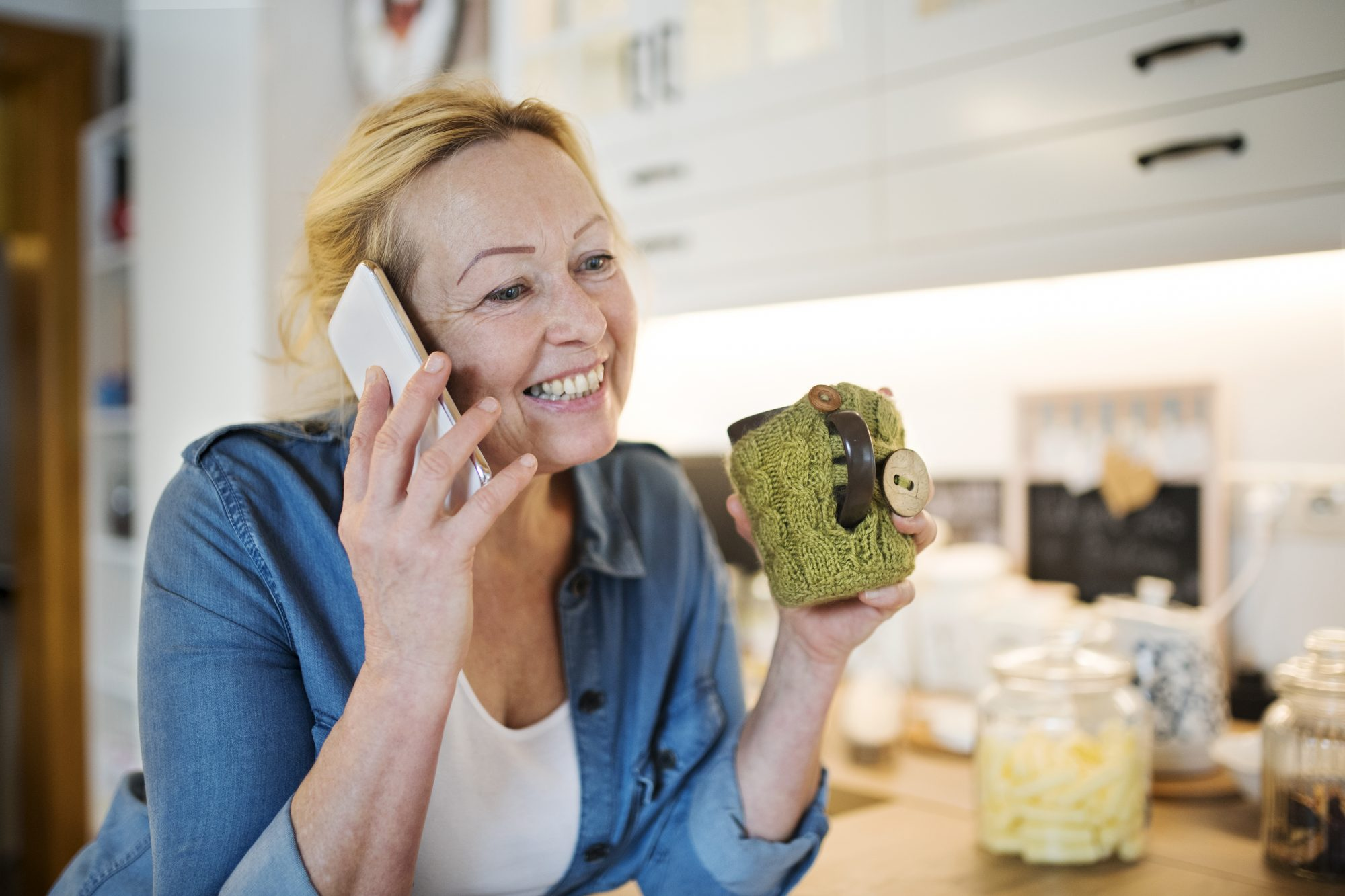 Older Woman Talking on Cell Phone While Drinking Coffee